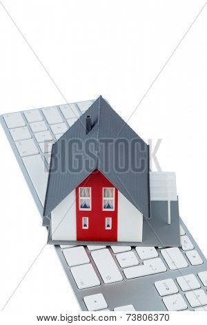 house on keyboard symbol photo for home purchase and rental on the internet