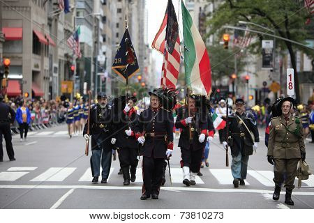 Uniformed marchers color guard