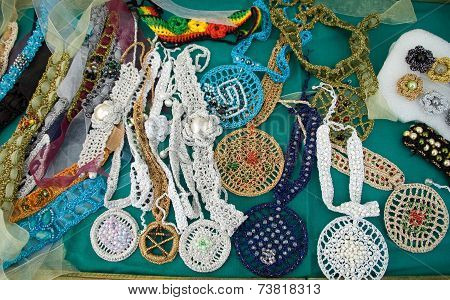Brooches, necklaces, earrings and ornaments from wool and jewelery