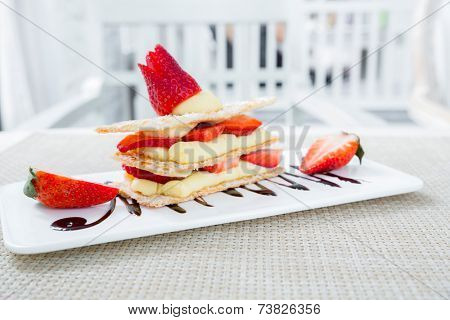 Strawberry Mille Feuille cake in white plate