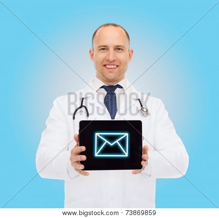 medicine, profession, and healthcare concept - smiling male doctor with stethoscope showing tablet pc computer screen over blue background