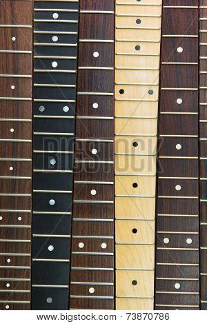 Six guitar necks aligned, Rosewood, maple and ebony fingerboard necks
