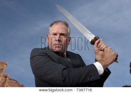 Sword Wielding Businessman