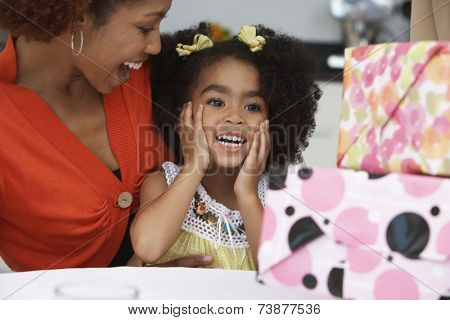 Young girl receiving birthday presents
