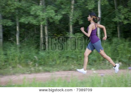 Attractive Young Female Power Walking