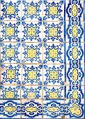 Detail of blue and yellow geometric portuguese glazed tiles. poster