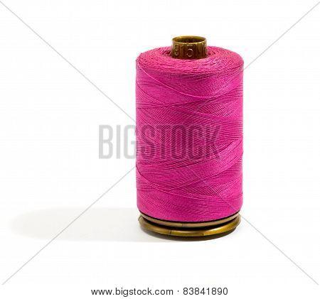 Close Up Dark Pink Cotton Thread On A Reel