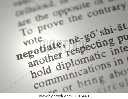 The word negotiate from the dictionary showing a shallow depth of field poster