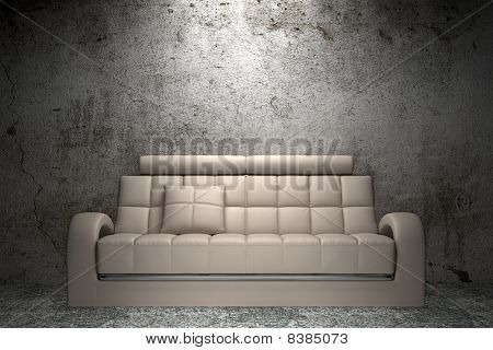 beige leather sofa in front of grunge concrete wall