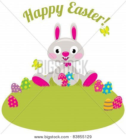 Easter Bunny And Colored Eggs In The Grass