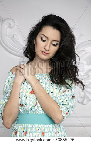 beautiful brunette woman face with tousled black hair