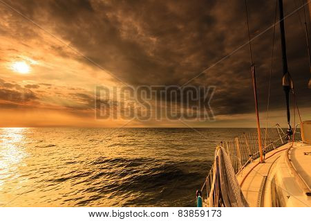Yachting Yacht Sailboat In Baltic Sea At Sunset Sunrise.