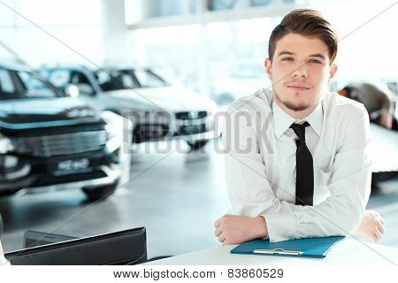 Handsome young man in dealership