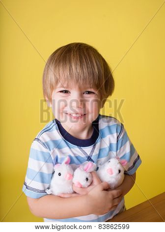 Child Playing With Easter Bunny Toys