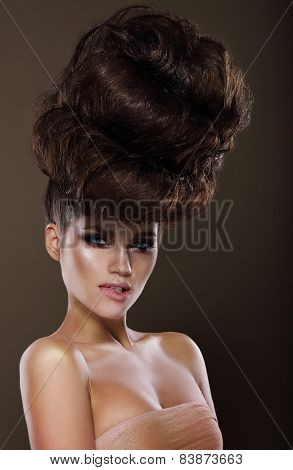 Updo. Trendy Woman With Creative Hairstyle