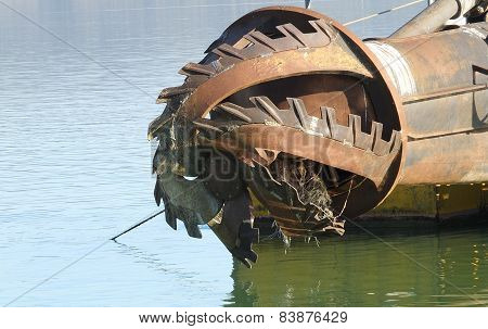 rotor with blade of a big dredge in a channel poster