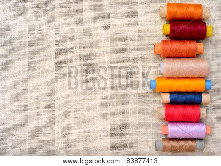 Copyspace image with sewing threads on linen