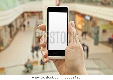 Smartphone With Empty Screen In Woman Hand In Shopping Center