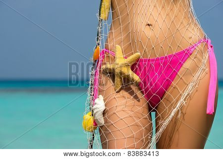Beautiful Female Body On The Beach, Conceptual Image Of Vacation, Spa, Travel And Summertime Holiday