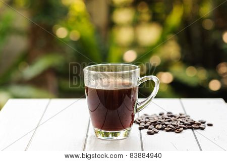 Black Coffee And Bean On White Tile