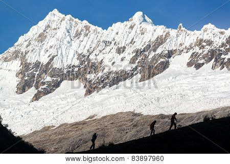 Hikers silhouetted against the Cordillera Blanca part of the Andes mountains near Huaraz Peru poster