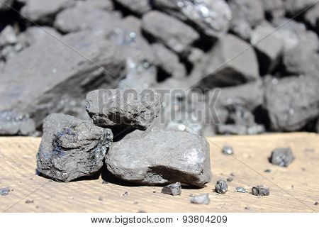 Coal Lump On A Background Of Solid Carbon Stack
