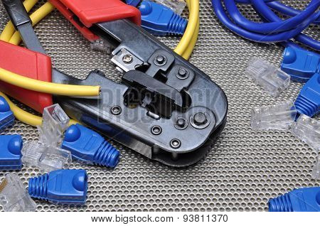 Crimping tool with network cable and connectors