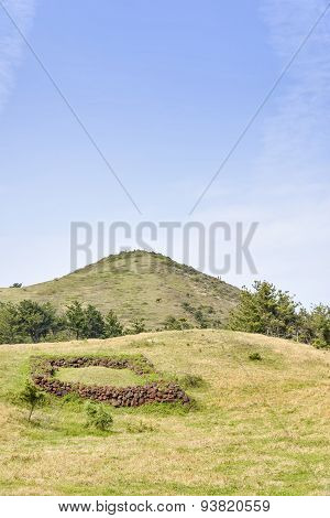 Landscape Of Songaksan Mountain With Jeju Traditional Tomb
