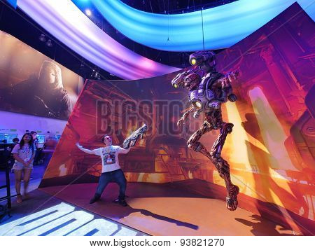LOS ANGELES - June 17: Man fighting cyborg monster model from DOOM video game at E3 2015 expo. Electronic Entertainment Expo, commonly known as E3, is an annual trade fair for the video game industry