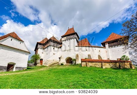 Transylvania Romania. Image of fortified church of Viscri UNESCO heritage site german landmark in romanian country.