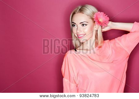 Pleasant woman with flower in her hair