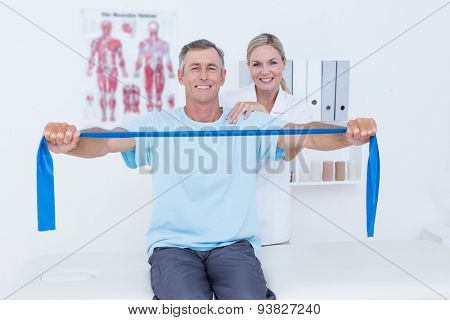 Doctor examining her patient back in medical office