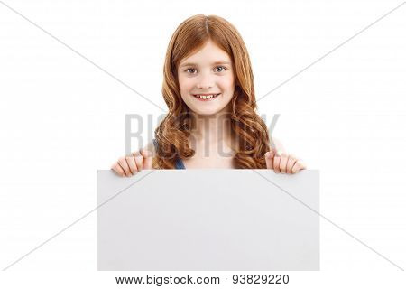 Positive girl holding white board
