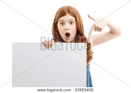 Surprised girl holding  white board
