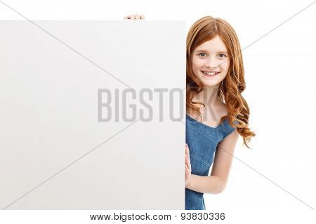 Pretty little girl looking out of box