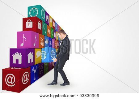 Businessman contorted with hands down against app box