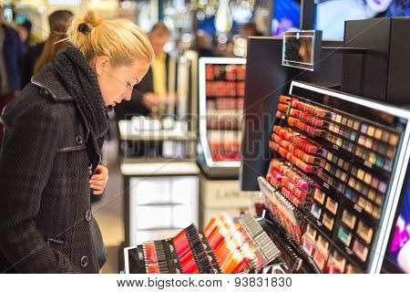 Beautiful woman shopping in beauty store.