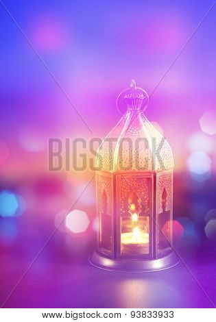 A festive Ramadan background. Abstract light effects with arabic lantern. Stock photograph.