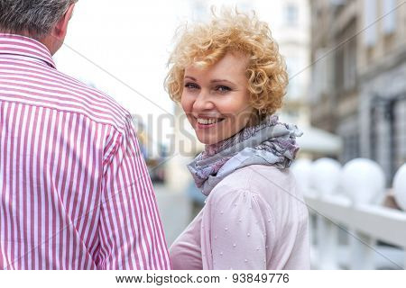 Portrait of happy middle-aged woman with man outdoors