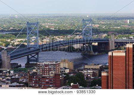 The Benjamin Franklin Bridge crosses the Delaware River connecting Philadelphia, Pennsylvania and Camden New Jersey.  The suspension bridge has been in service since 1926