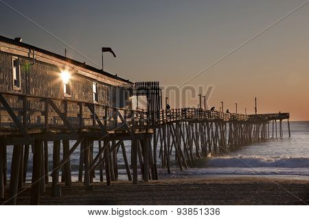 Avalon fishing Pier in Kitty Hawk on the Outer Banks is a popular destination. poster