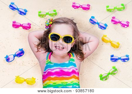 Little Girl With Sun Glasses On A Beach