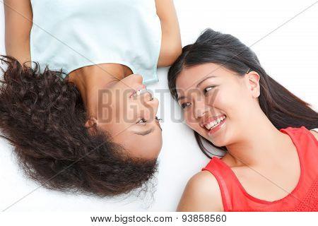 Happy friend lying on the floor