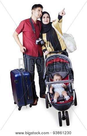 Two Parents Travelling With Their Baby
