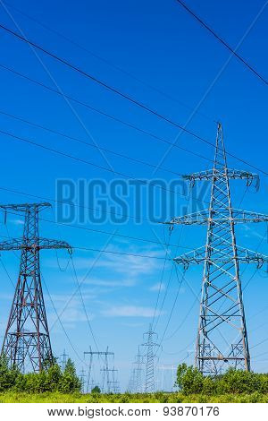 Electric wires on a column about high volt poster