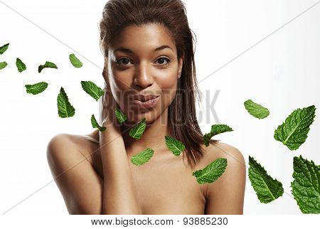 Black Woman Touching Blow Out Freshness, Leavs Of Mint