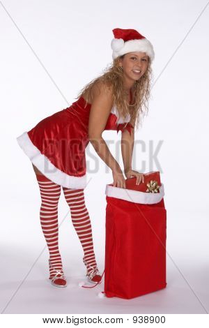 Sexy Blonde Female Santa In Red Dress With Stripped Stockings