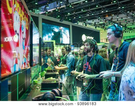 LOS ANGELES - June 17: Gamers playing demo XBOX games at E3 2015 expo. Electronic Entertainment Expo, commonly known as E3, is an annual trade fair for the video game industry