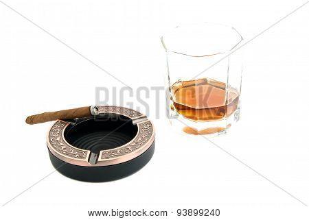 Cigarillo In Ashtray And Cognac
