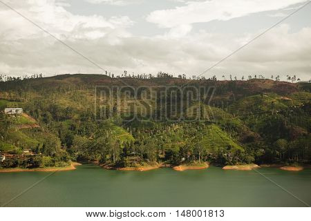 travel, tourism, nature and landscape concept - view to lake or river from land hills on Sri Lanka
